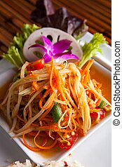 Som Tum Papaya Salad - Traditional dish of freshly prepared...
