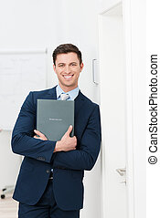 Smiling confident young job applicant holding his curriculum...