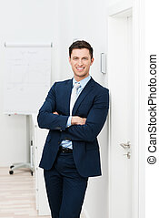 Confident relaxed young businessman in a stylish suit...