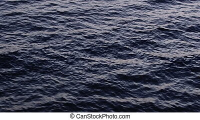 Night falls over the sea surface - Night falls over the wavy...