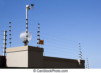Electric Fence and Security Camera Atop Boundary Wall -...