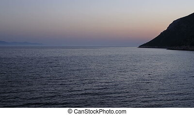 Night falls over the coast in Dubrovnik archipelago -...