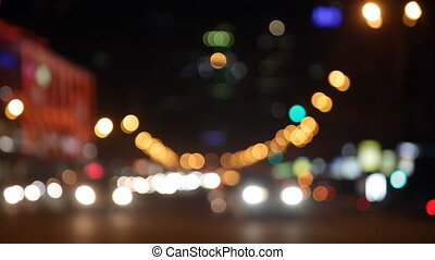 Night city lights and traffic background Out of focus...