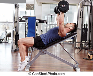 Chest workout on bench press - Athletic man working out his...
