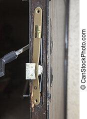 Damaged door after housebreaking - Damaged door and lock...