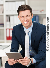 Businessman holding a tablet computer - Handsome young...