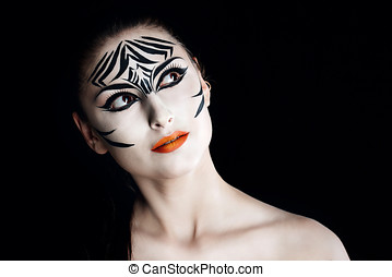 Girl zebra - Attractive young girl with make-up of wild...