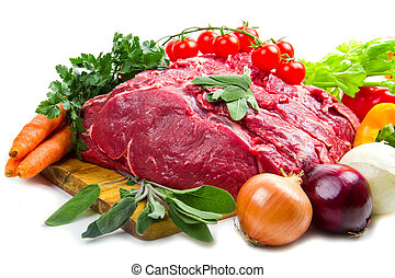 huge red meat chunk with vegetables isolated over white...