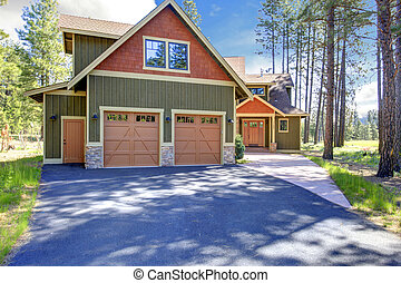 House exterior. View of garage and driveway