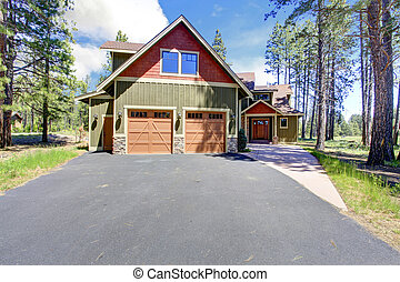House exterior View of garage and driveway - Big luxury...