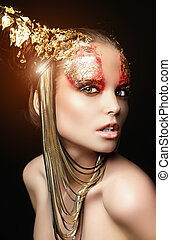 goddess - Art project: beautiful woman with golden make-up....