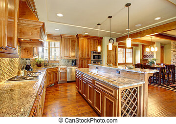 Spacious kitchen room with island - Spacious kitchen room...