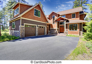 House exterior. View of garage and driveway - Big luxury...