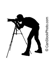 Photographer shooting Side view silhouette of man using...