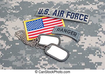 US ARMY ranger tab with blank dog tags on camouflage uniform