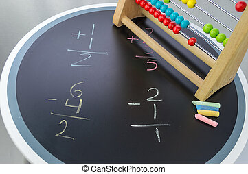 Math time with abacus - Math study on a blackboard table...