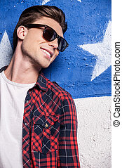 Cool and trendy handsome. Cheerful male model in checked...
