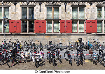 Bicycles in front of an old Dutch historic building