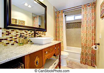Bathroom with antique cabinets