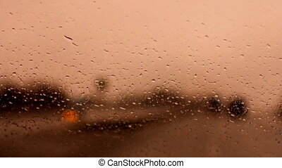 raindrops on a car windshield b - ride on the highway in the...