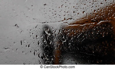 raindrops on a car windshield e - ride on the highway in the...