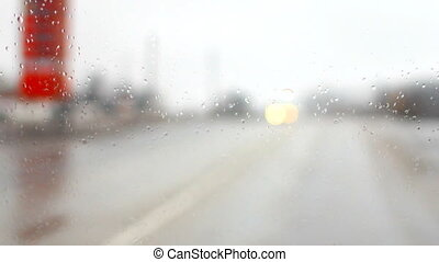 raindrops on a car windshield f - ride on the highway in the...
