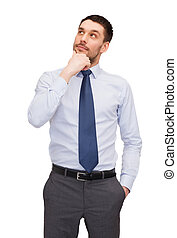 handsome buisnessman looking up - business and office...