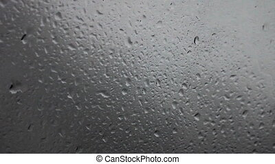 raindrops on a car windshield - ride on the highway in the...