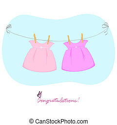 two dresses - two pink dress hanging on a clothesline