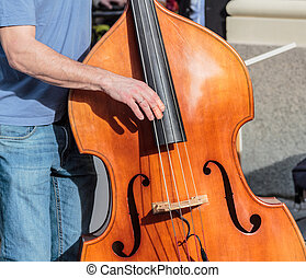 Classic standup bass played on the street - A wooden classic...