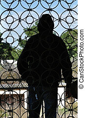 man and vintage iron gate