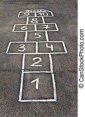 Cells for game hopscotch drawn with chalk on the pavement