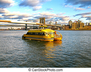 Water Taxi and Brooklyn bridge, seen from Pier 17, at Lower...