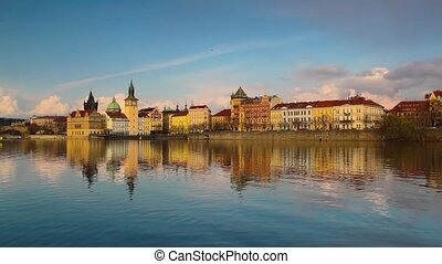 Charles Bridge in Prague at sunset - View from Kampa of...