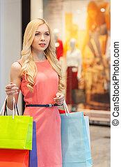 Woman shopping. Beautiful young woman shopping in mall
