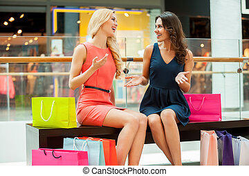 Shopping is fun. Two beautiful young women with shopping bags at mall