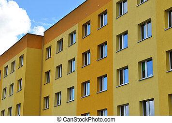 Big condominium apartment block. Skyscraper building house.