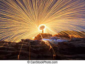 Steel wool spinning - A golden line of steel wool is created...