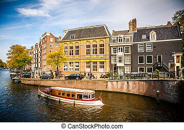 Amsterdam cityscape - Boat on canal in Amsterdam