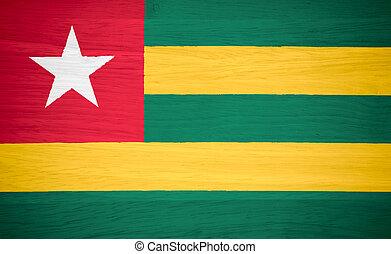 Togo flag on wood texture