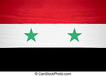 Syria flag on wood texture