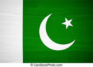 Pakistan flag on wood texture