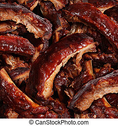 Ribs grilled barbecue meat with a close up view of a group...