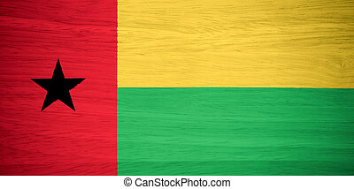 Guinea Bissau flag on wood texture