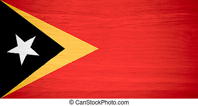 East Timor flag on wood texture