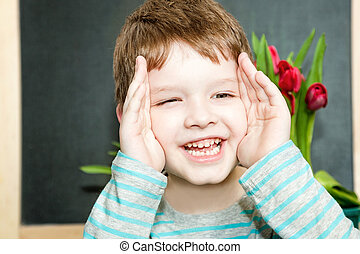 Cute boy playing peekaboo.