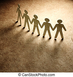 Group of paper people holding hands. Teamwork concept