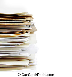 Filing - Pile of files on plain background