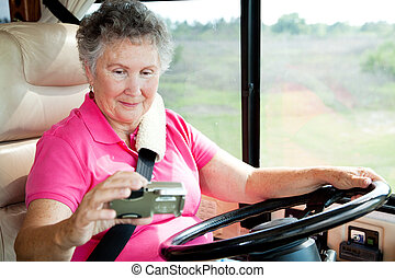 RV Senior - Woman Using GPS - Senior woman using a GPS to...
