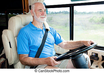 RV Senior - Driving - Senior man on vacation driving his...